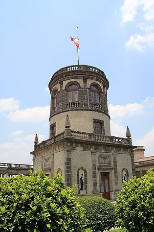 Front of Chapultepec Castle with a Mexican flag on top.