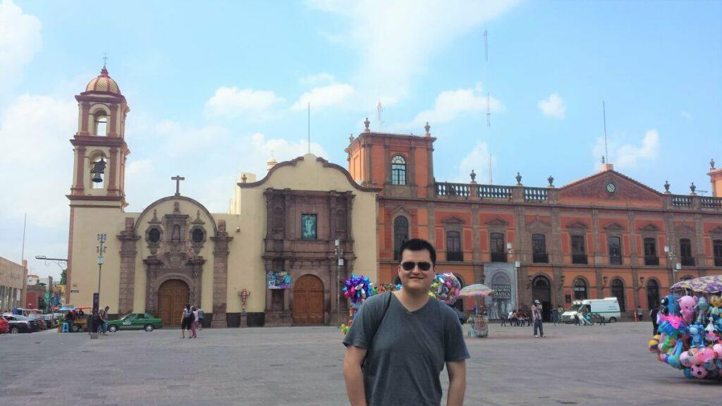 Young man in front of old buildings in San Luis Potosi.