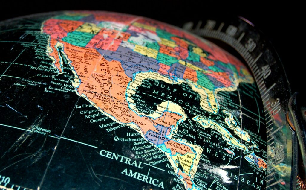 Black globe with Mexico map in the center.