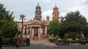 Plaza de Armas with pink stone buildings in San Luis Potosi City.
