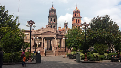 San Luis Potosi main square with a kiosk in the center and the cathedral in the background.