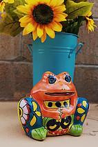 Frog-shaped talavera flowerpot holder.