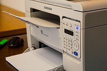 Samsung printer printing out documents.