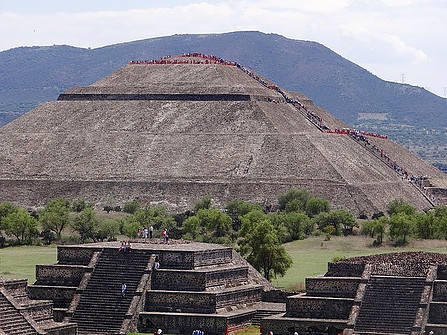 Two smaller pyramids with a taller one in the back in Teotihuacan.