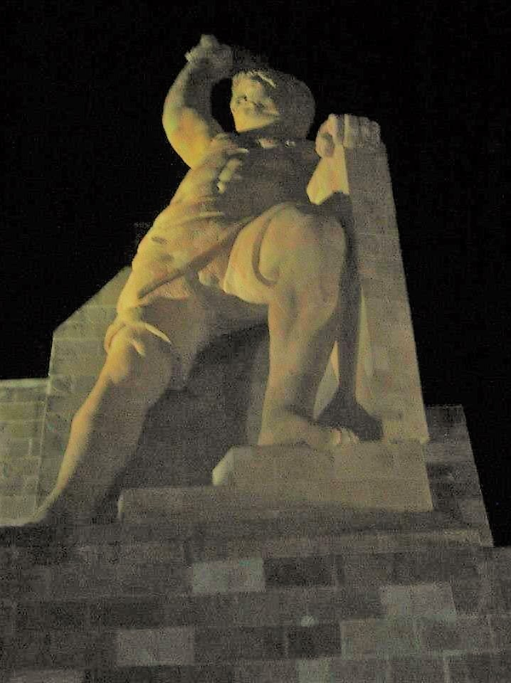 Statue of a man holding a torch.