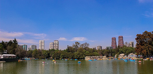 People riding boats in Chapultepec lake.