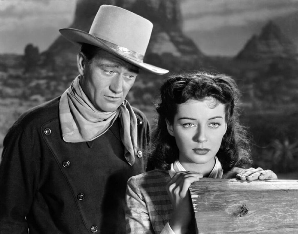 Shot of a male and femaile character in a black and white movie.