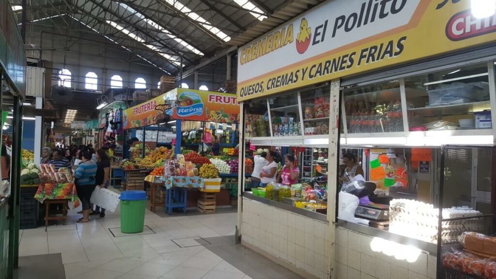 Interior of a local Mexican market with fruits and vegetables on display.