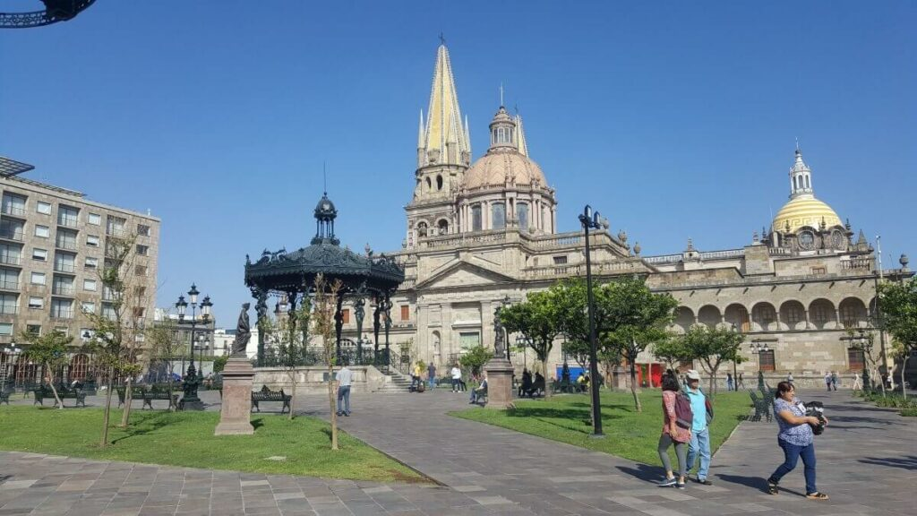 Guadalajara main square with a kiosk in the center and the cathedral in the background.
