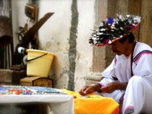 Huichol man sending handmade jewelry.