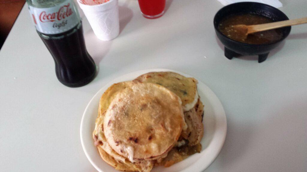 A olate of Mexican gorditas and a diet coke.