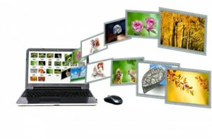 Laptop displaying several images of people, flowers, and animals.