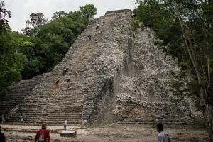 People climbing a pyramid in Coba, Mexico.