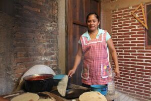 Traditional Mexican cook making tortillas.