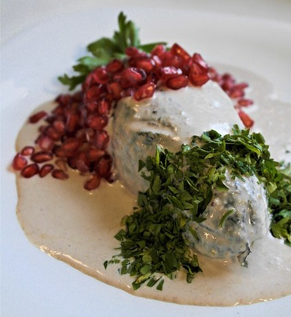 Chile en nogada with pomegranate and parsley.