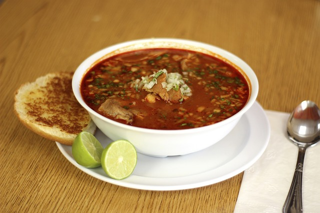 A bowl of red pozole.