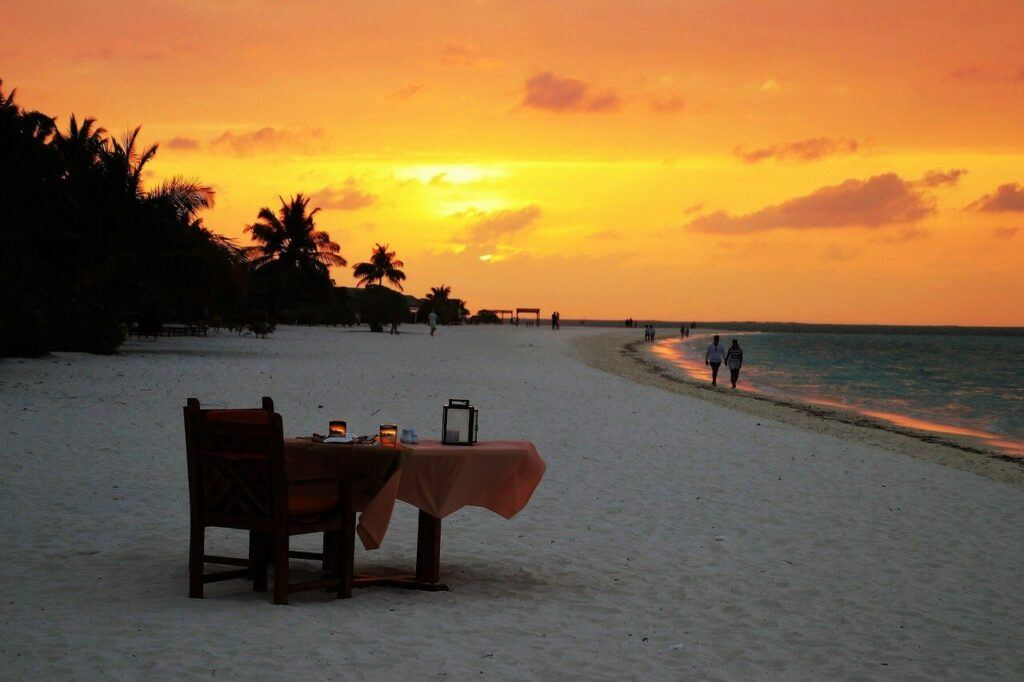 A table set for dinner during sunset.