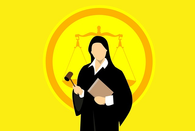 A female judge dressed in black and holding a gavel in her hand.