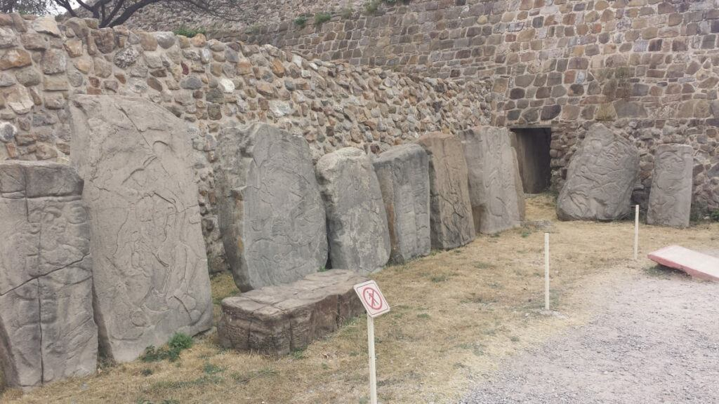 Various steles and the entrance to an ancient tomb.