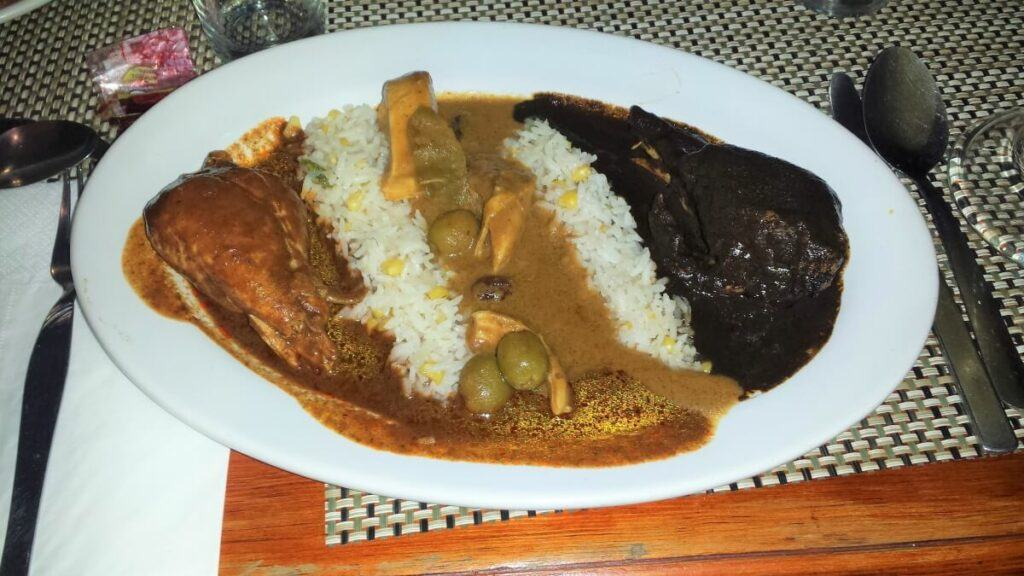 Three different kinds of mole with chicken and rice.