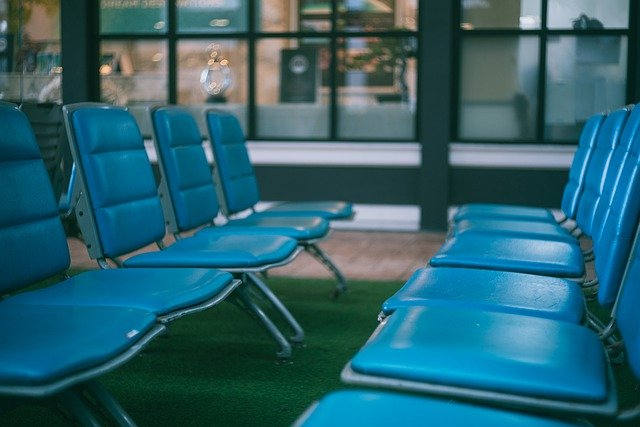 Empty blue seats at an aiport.