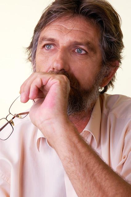 A medium-age man thinking.