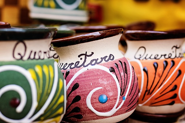 Three colorful pottery cups with the word Queretaro on them.