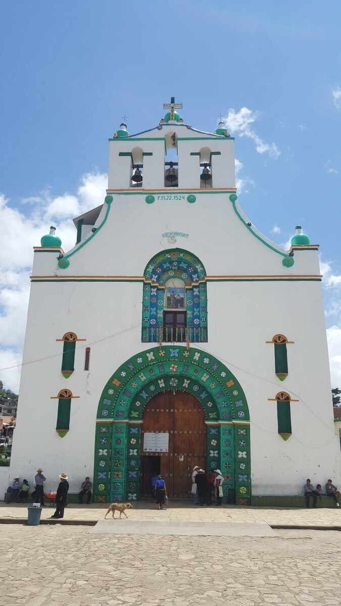 A white church with green decorations.