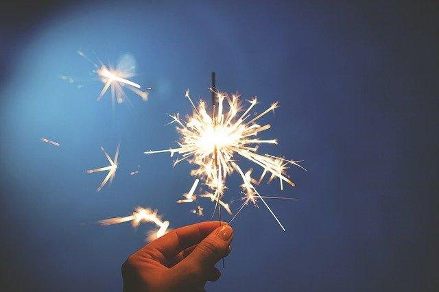 A hand holding a sparkler.