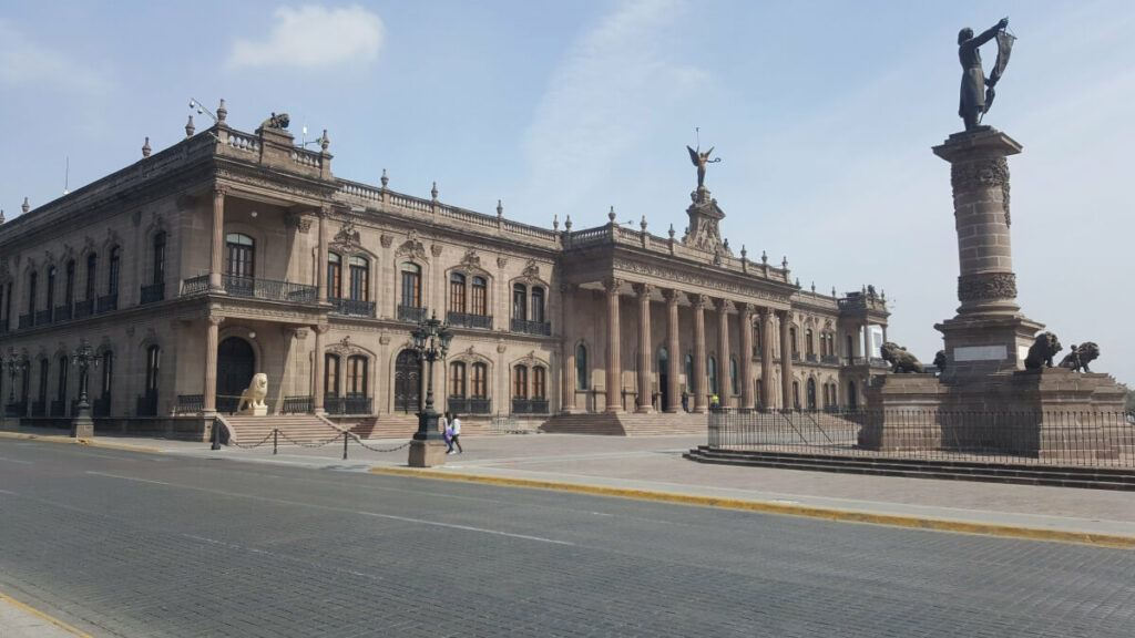 The old Nuevo Leon Government Palace with a statue in front of it.