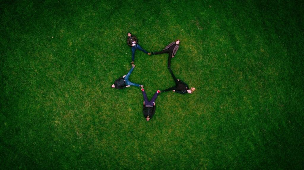 A group of people forming a star.