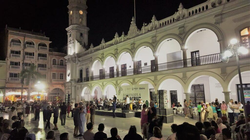 A group of people dancing at night.