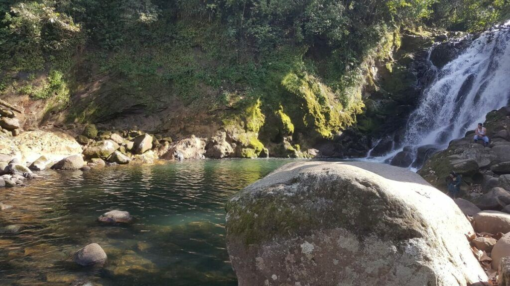 A waterfall and a swimming hole.