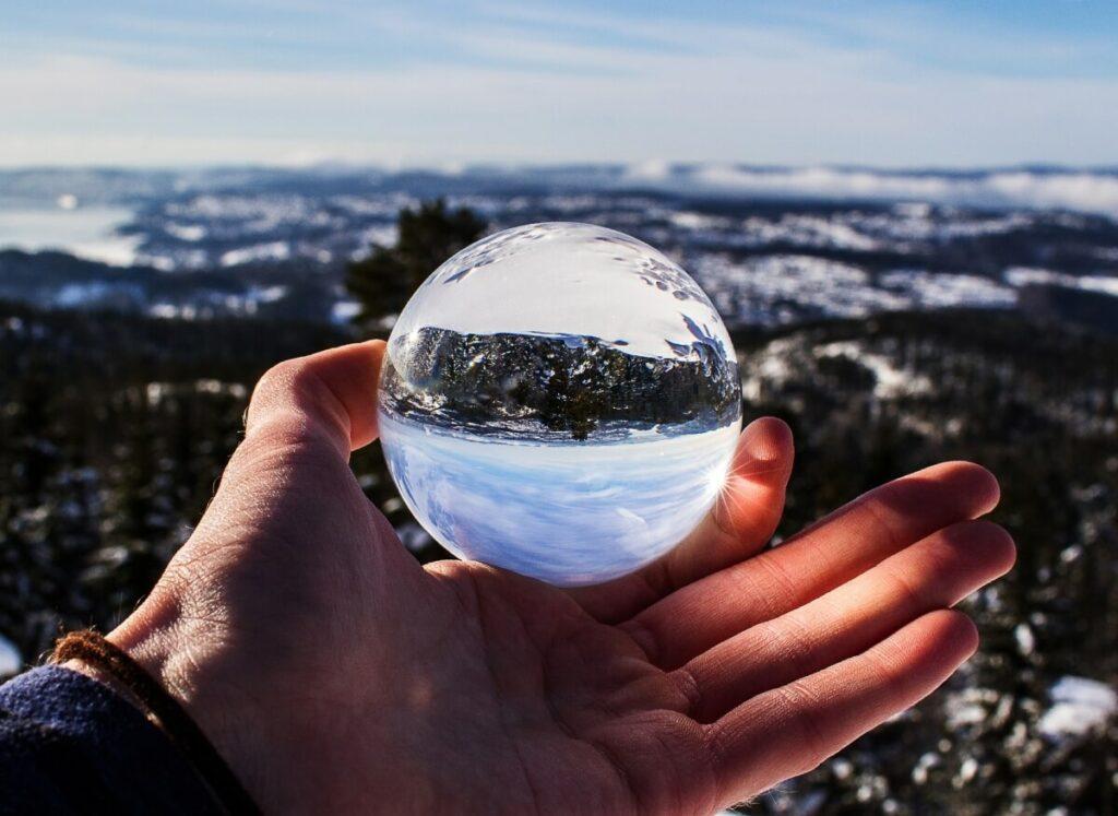 A hand holding a crystal ball.