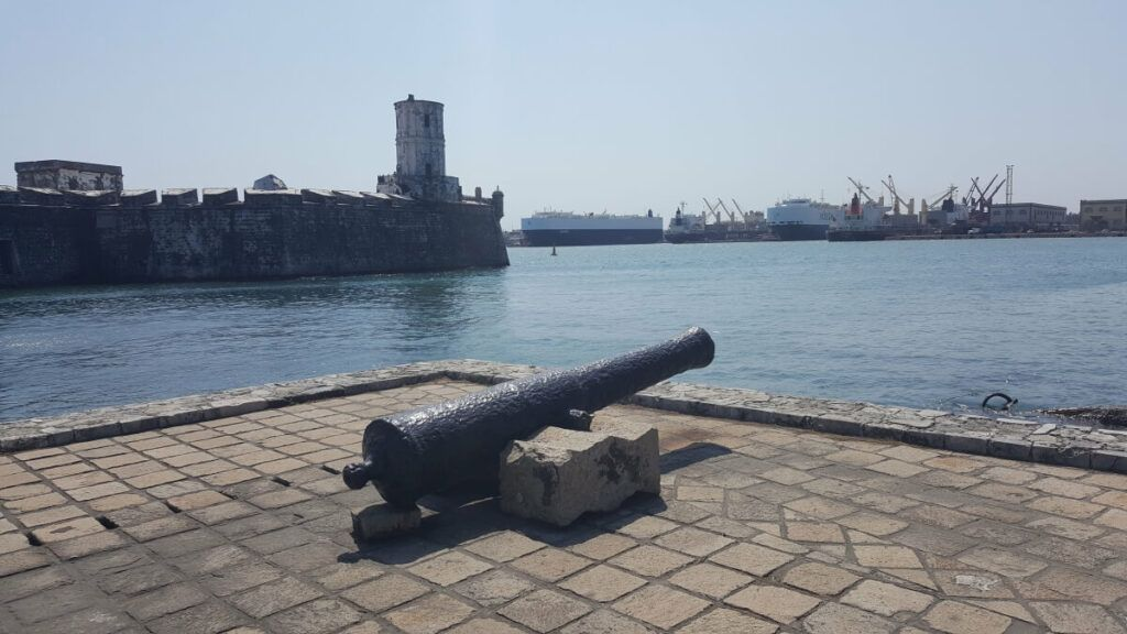 A cannon by a former fortress in the sea.