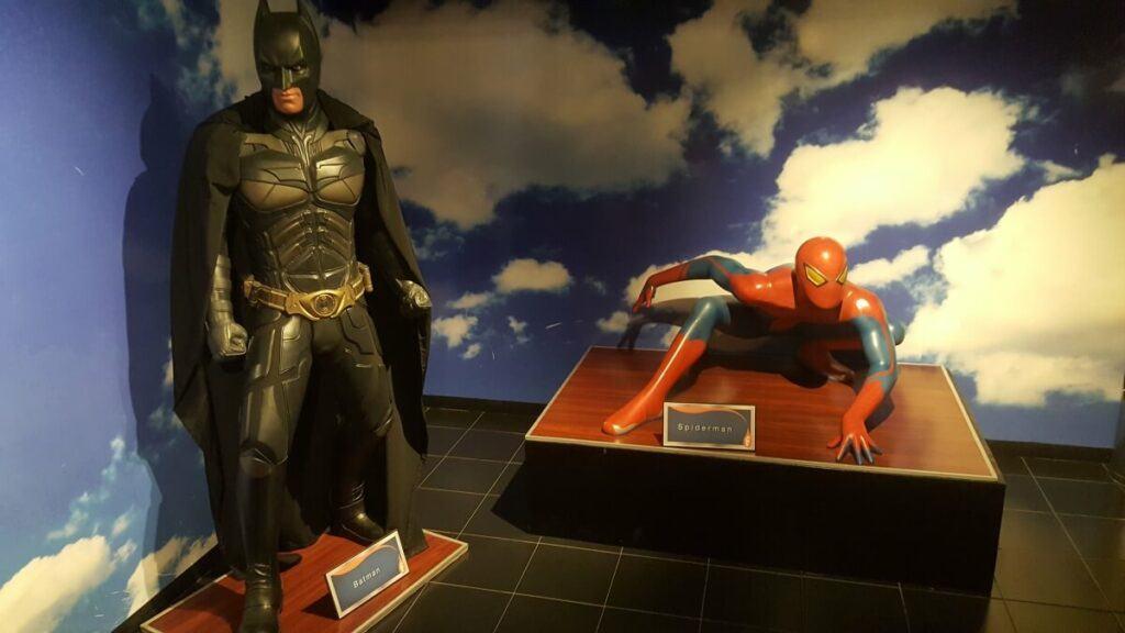 Batman and Spiderman wax figures.