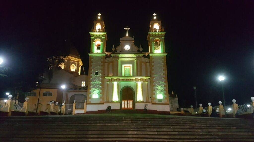 A church lit up in yellow colors.