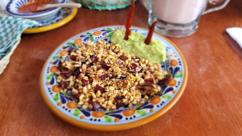 A plate with ant eggs and guacamole.
